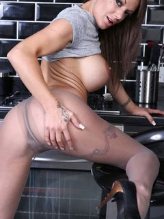 Big titted babe LouLou spreads her cunt in tights