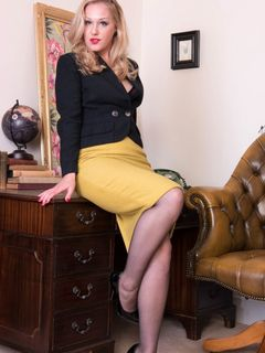 Aston Wilde strips and teases in black pantyhose