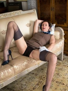 Mature lady Lara Latex spreads in vintage clothes