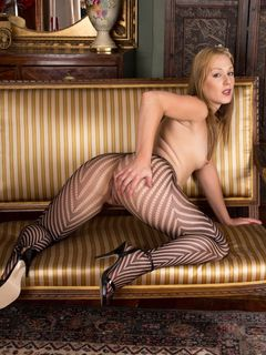 Aston Wilde shows off in a pair of striped hose