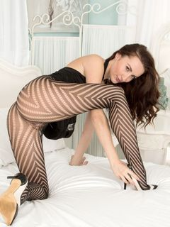 Sophia Smith teases in her black pantyhose on bed