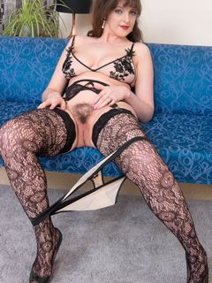 Kate Anne spreads her pussy in fishnet stockings