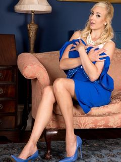 Blonde Sapphire Blue shows long legs in nylons