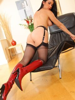Bryoni Kate wears a red miniskirt with stockings