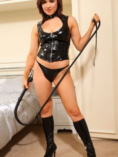Jocelyn Kay is wearing a PVC top and high boots