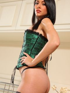 Bryoni Kate is dressed in a green corset and nylon
