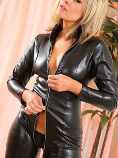 Mistress Naomi K plays in her leather catsuit
