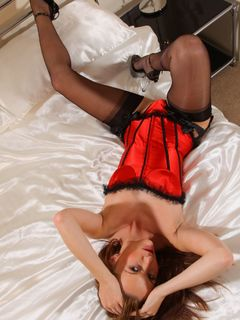 Sophia Smith in her red corset and black stockings