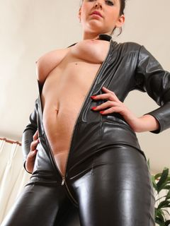 Mistress Bryoni Kate spreads in her latex catsuit