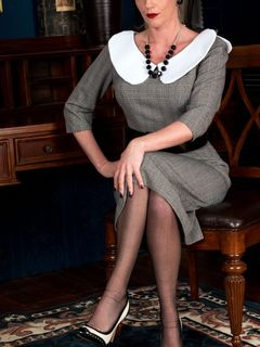 Holly Kiss stripping in vintage black nylons