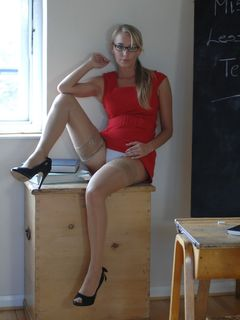Blonde teacher Hayley Marie Coppin in a red dress