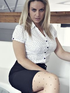 Busty Kate Banks strips from tights and models
