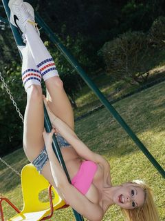 Busty Lolly Lopez teases and stips on the swings