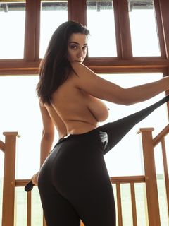 Big titted Joey Fisher showing her hot round ass