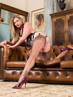 Blonde long legged Holly Kiss poses in her nylons