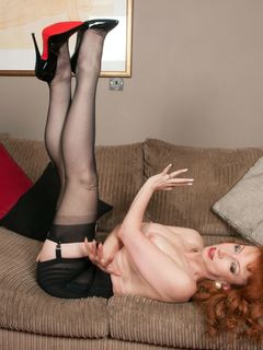Busty redhead Red XXX toying in vintage stockings
