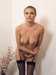 Busty Porchia Watson teasing in black stockings