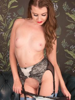 Long haired redhead Brook Logan strips in nylons