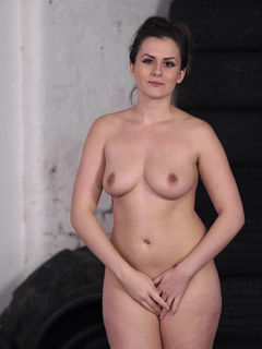 Gym instructor Charlotte Rose strips and poses