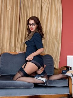 Glassed Jess West strips off in sexy black nylons