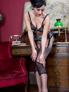 Cassie Clarke in black nylons spread on the table