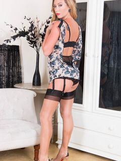 Curly blonde Natalia Forrest strips in stockings