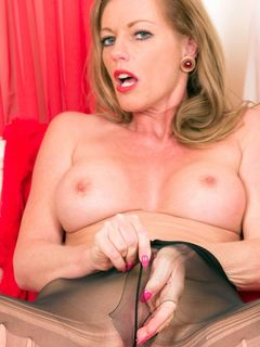 Holly Kiss rips her black pantyhose and spreads
