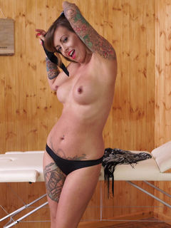 Tattooed babe Charlie Z strips and poses