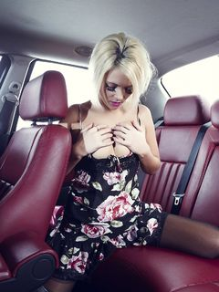 Hot nyloned blonde Jemma Reseigh teases in a car