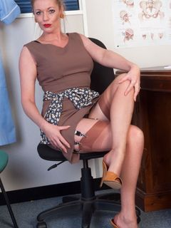 Secretary Holly Kiss in stockings teases at table