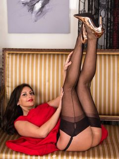 Sexy brunette Cassie Clarke teases in black nylons