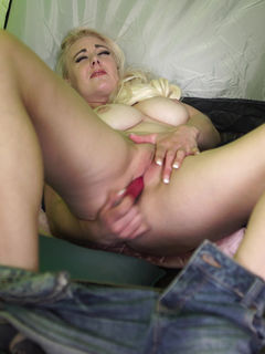 Blonde girl Sapphire Blue toys her pussy in a tent