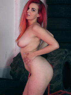 Bad Dolly strips down and models in a garage