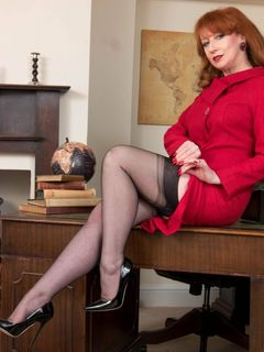 Redhead lady Red XXX teases in her black nylons